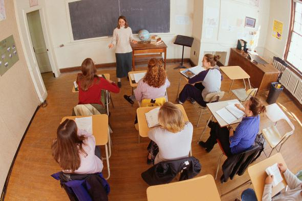 Teacher in front of a classroom of students